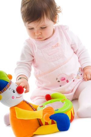 Happy baby girl sitting on floor playing with toy smiling, cotout on white background. Stock Photo - 5943430