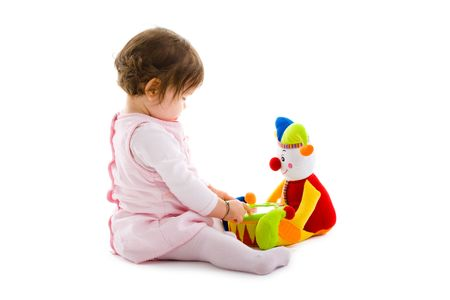 Happy baby girl sitting on floor playing with toy smiling, cotout on white background. Stock Photo - 5943474