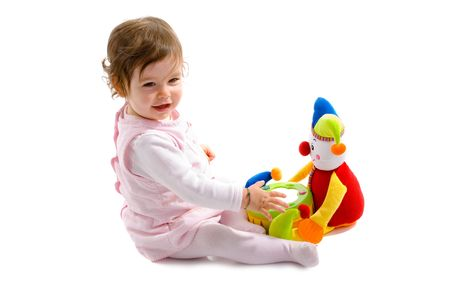 Happy baby girl sitting on floor playing with toy smiling, isolated on white background. Stock Photo - 5943381