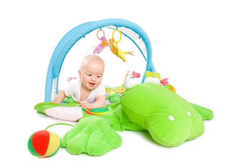 Happy baby playing in baby gym toy, isolated on white background. photo