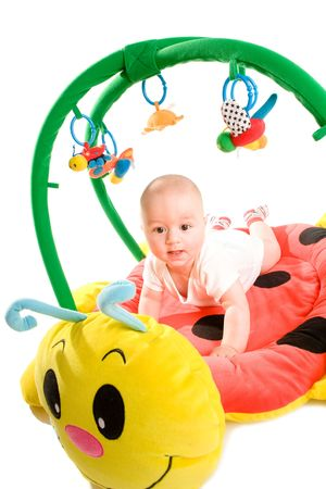 Happy baby playing in baby gym toy, isolated on white background. Stock Photo - 5943409