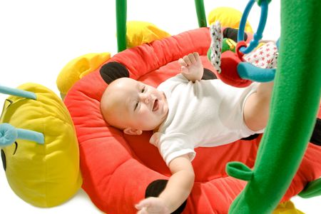 Happy baby playing in baby gym toy, isolated on white background. Stock Photo - 5943412