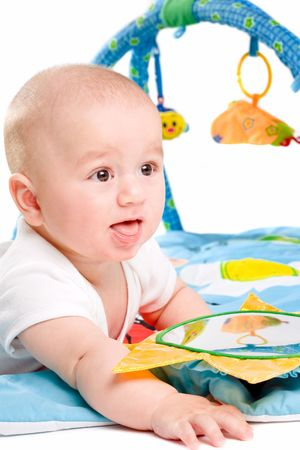 Happy baby playing in baby gym toy, isolated on white background. Stock Photo - 5943429