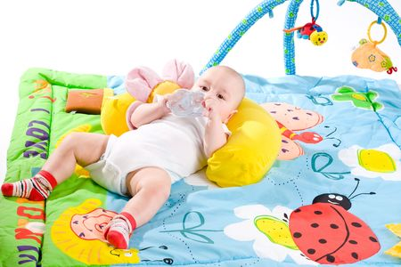 Happy baby playing in baby gym toy, isolated on white background. Stock Photo - 5943472