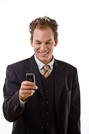 businesswear: Businessman writing text message on mobile phone, white background.