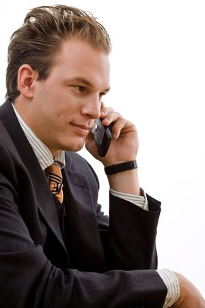 businesswear: Businessman talking on mobile phone, isolated on white background.