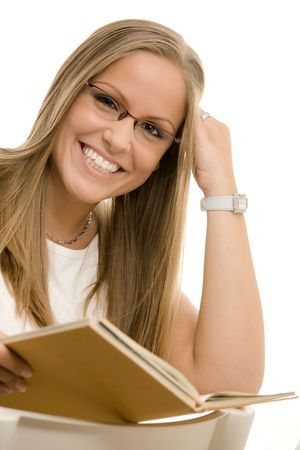 only: Closeup protrait of beautiful college girl reading book. Isolated on white background.
