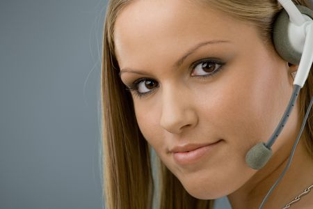 Young female customer service representative in headset. Stock Photo - 5982491