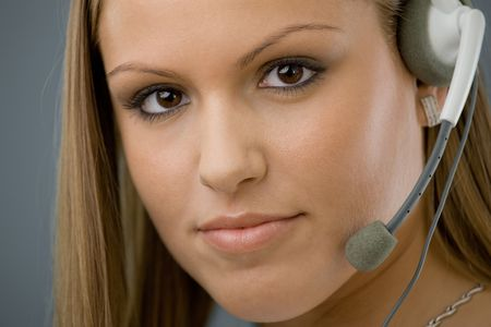 Young female customer service representative in headset. Stock Photo - 5982677