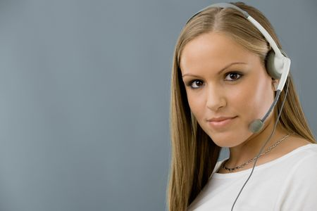 Young female customer service representative in headset. Stock Photo - 5982732