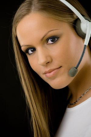 Young happy beautiful customer service operator girl in headset, smiling, isolated on black background. Stock Photo - 5982692