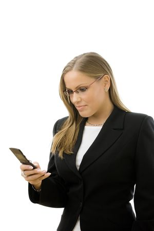 businesswear: Young happy businesswoman writting text message on mobile phone, smiling, isolated on white background.