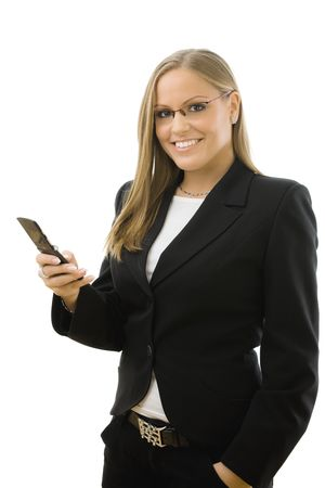 Young happy businesswoman writting text message on mobile phone, smiling, isolated on white background. photo