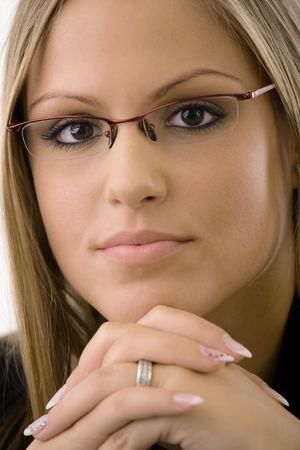 Closeup portrait of young businesswomen wearing glasses. Thinking, leaning on hands, looking at camera. Isolated on white background. Stock Photo - 5982722