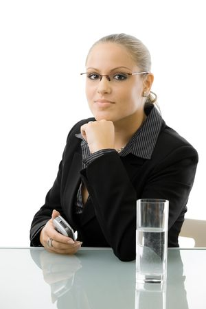 Young attractive businesswoman working at at desk, thinking, isolated on white background. Stock Photo - 5982683