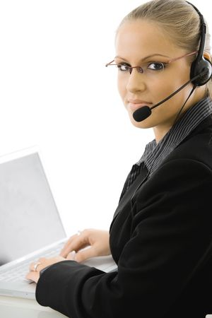 Happy young customer service operator girl wearing headset, working on laptop computer, smiling, isolated on white background. photo