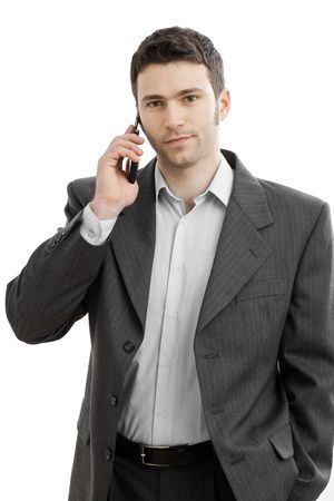 Casual businessman talking on mobile phone. Isolated on white.  photo