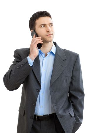 businessman talking: Casual businessman talking on mobile phone. Isolated on white.