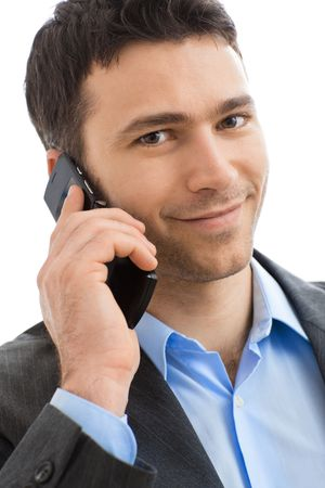 european expression face: Closeup portrait of casual businessman talking on mobile phone. Isolated on white.