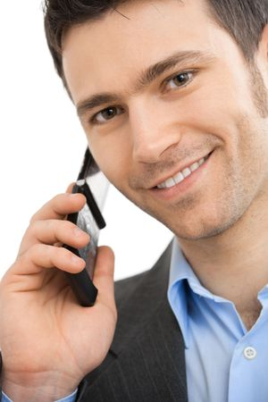 Closeup portrait of casual businessman talking on mobile phone. Isolated on white.  photo