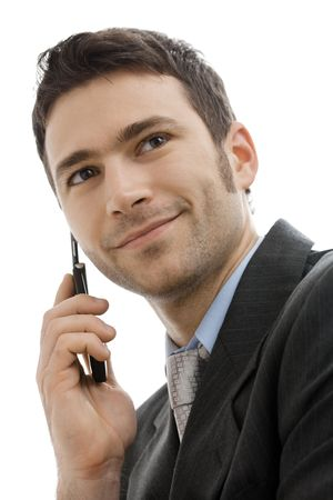 Closeup portrait of casual businessman talking on mobile phone. Isolated on white. Stock Photo - 5982838