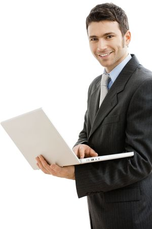 office wear: Businessman using laptop computer, standing, smiling. Isolated on white background.
