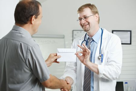 doctor giving glass: Medical office - patient bribing doctor, giving money in envelope.