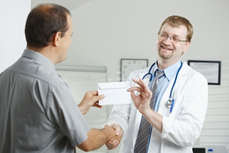 doctor money: Medical office - patient bribing doctor, giving money in envelope.