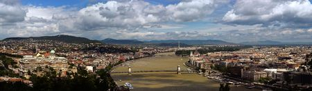 on both sides: This is a panorama of Budapest, the capital of Hungary. It lies on both sides of the river Danube.