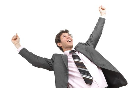 Portrait of happy young businessman standing in winning pose with hands raised, smiling.  Isolated on white. photo