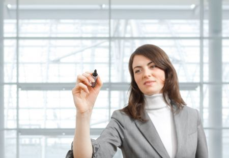 marker pen: Young businesswoman drawing with marker pen, selective focus on hand. Stock Photo