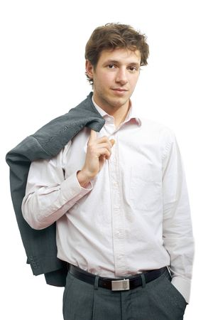 undoubting: Young businessman standing in confident pose with hands in pocket and his suit draped over his shoulder. Isolated on white.