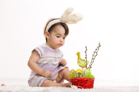 Baby girl in easter bunny costume, isolated on white background. photo