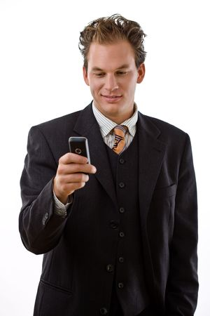 Businessman writing text message on mobile phone, white background. Stock Photo - 6224410