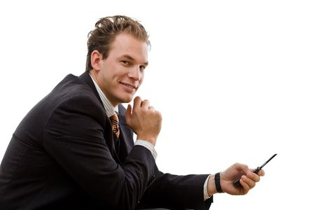 Businessman sending SMS on cellphone, isolated on white background. photo