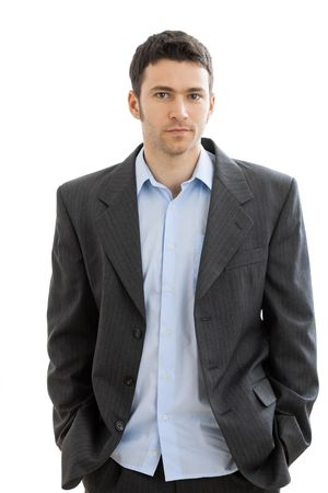 formal attire: Portrait of tired businessman after work, in open collar shirt without tie.