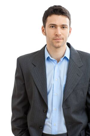 Happy casual businessman wearing suit and open collar shirt without tie, smiling.