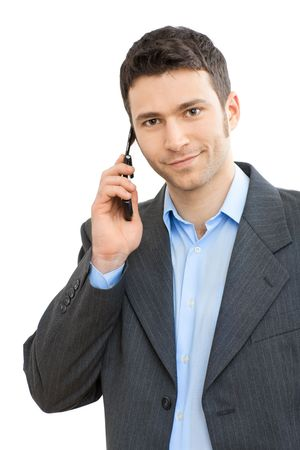 Portrait of casual businessman talking on mobile phone. Isolated on white.  photo