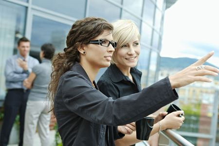 Businesswomen having break on office terrace outdoor drinking coffee. Stock Photo - 6254342