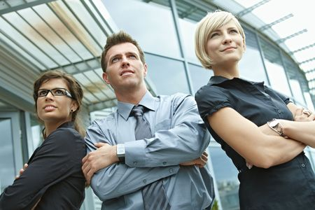 Group of dedicated young business people posing outdoor in front of office building. Stock Photo - 6254357