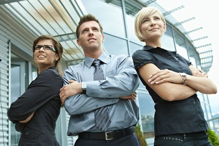 Group of dedicated young business people posing outdoor in front of office building. Stock Photo - 6254396