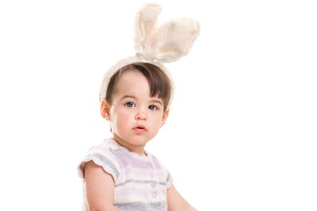 Closeup portrait of baby girl with bunny ears headband, isolated on white background. photo