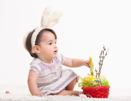 Baby girl in easter bunny costume, playing with chicken in easter basket. Isolated on white background. Stock Photo - 6254463