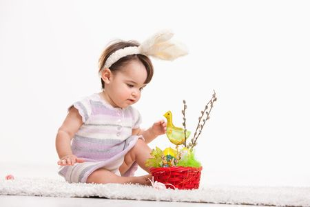 Baby girl in easter bunny costume, playing with chicken in easter basket. Isolated on white background. Stock Photo - 6254452