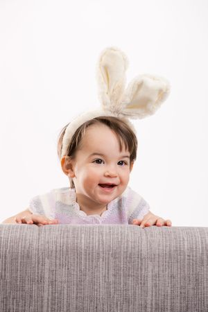 Closeup portrait of happy baby girl in easter bunny costume, laughing. Isolated on white background. Stock Photo - 6254485
