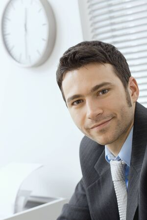 Portrait of young businessman at office. Stock Photo - 6285814