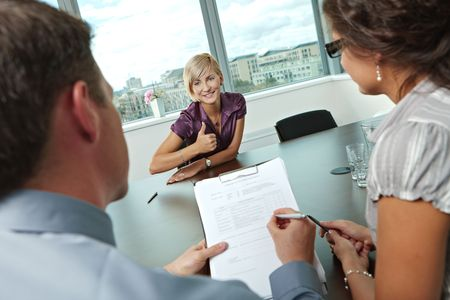 Happy woman applicant got the job by a successful job interview. Over the shoulder view. Stock Photo - 6285860