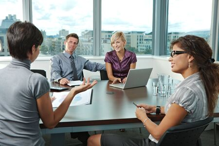 mediation: Group of young business people talking on business meeting at office.