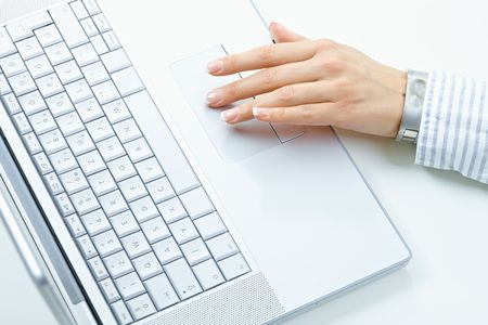 woman typing: Female hand using laptop computer keyboard. Stock Photo