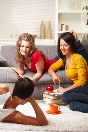 Happy highscool students learning in group at home, smiling. photo